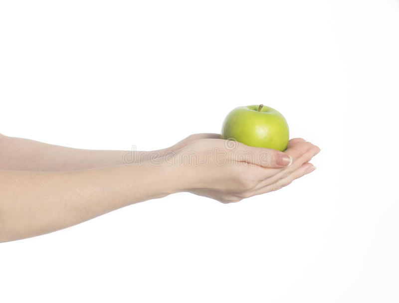 Mani con la mela verde fotografie stock