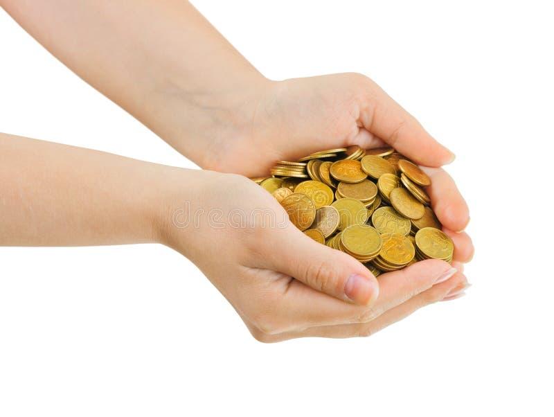 Mani con le monete immagini stock libere da diritti