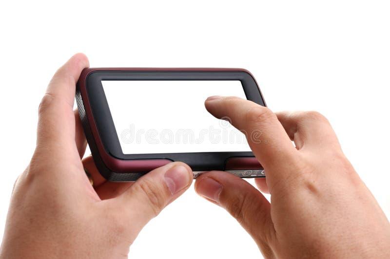 Mani con percorso di GPS su priorità bassa bianca fotografie stock libere da diritti