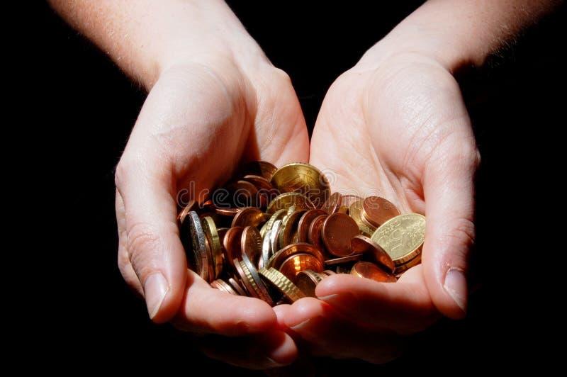 Mani con soldi fotografia stock