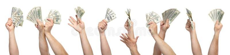 Mani con soldi immagini stock