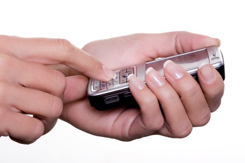Mani con un telefono mobile fotografie stock