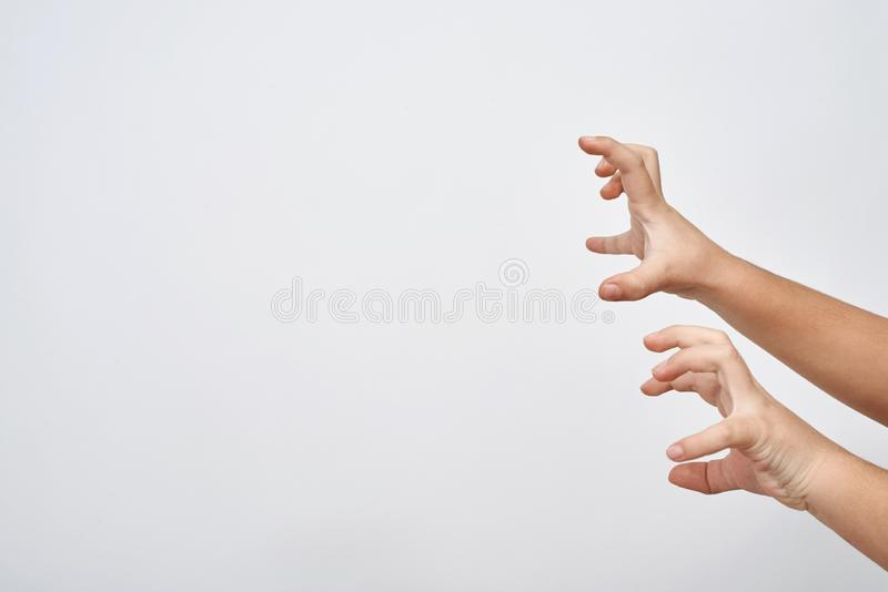 Mani del bambino che provano a spaventare Intimidazione puerile immagine stock