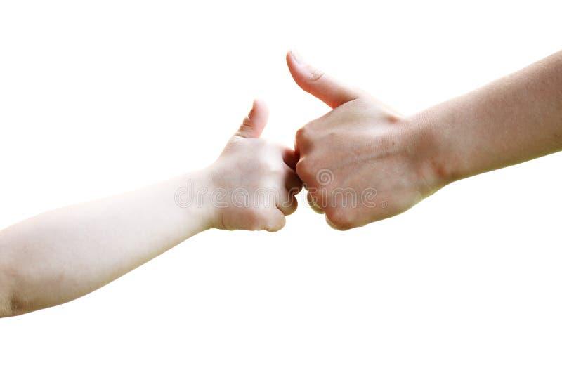 Mani del bambino e dell'adulto. fotografie stock libere da diritti