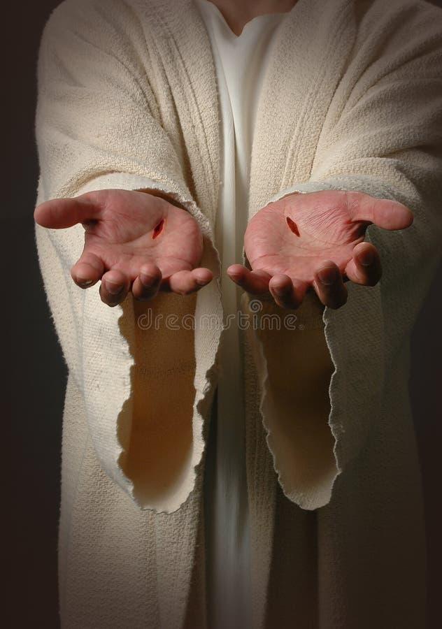 Mani del Jesus con le cicatrici fotografie stock libere da diritti