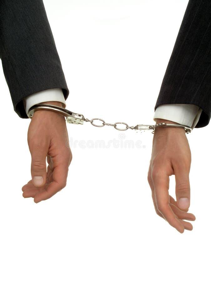 Mani dell'uomo d'affari in manette immagini stock libere da diritti
