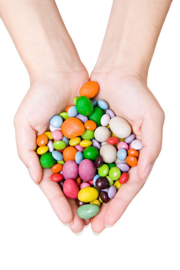 Mani della donna con i dolci immagine stock libera da diritti