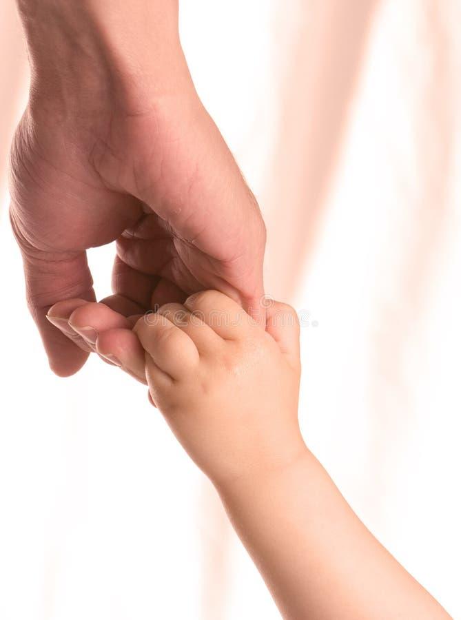 Mani della holding immagine stock