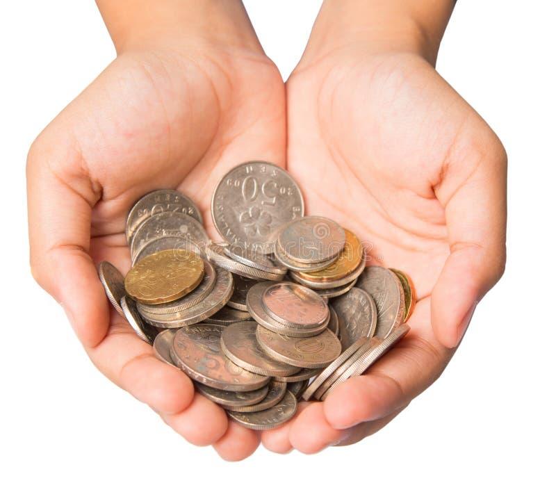 Mani della ragazza con le monete fotografia stock libera da diritti