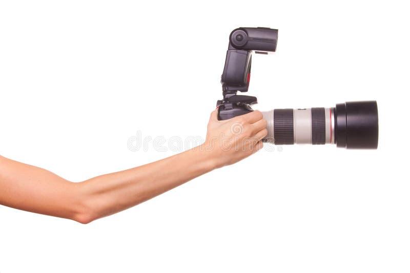 Mani delle donne che tengono la macchina fotografica. fotografie stock libere da diritti