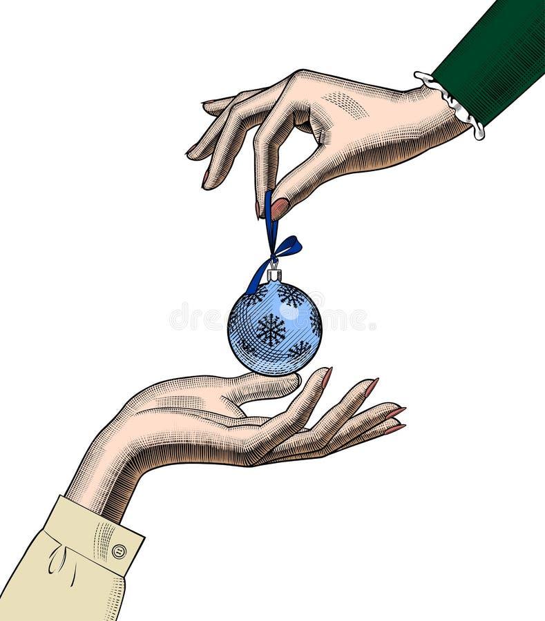 Mani delle donne con una palla dell'albero di Natale royalty illustrazione gratis