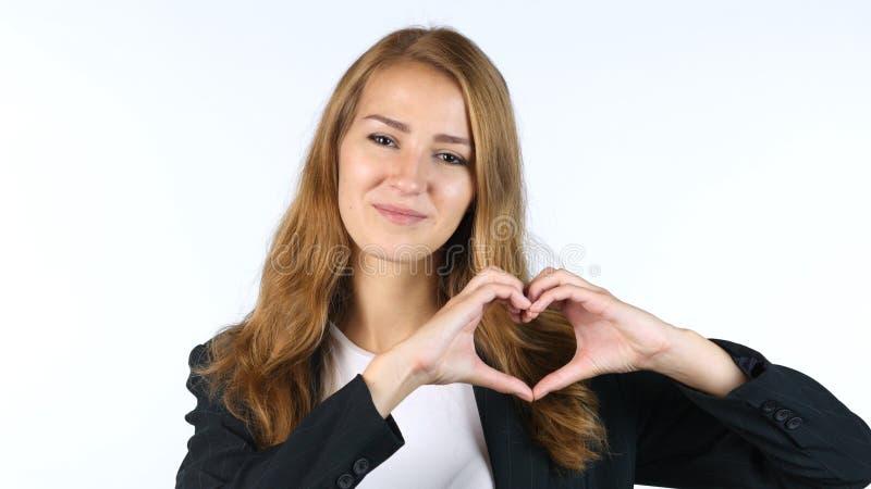 Mani di Making Heart With della donna di affari, pace, fondo bianco fotografia stock