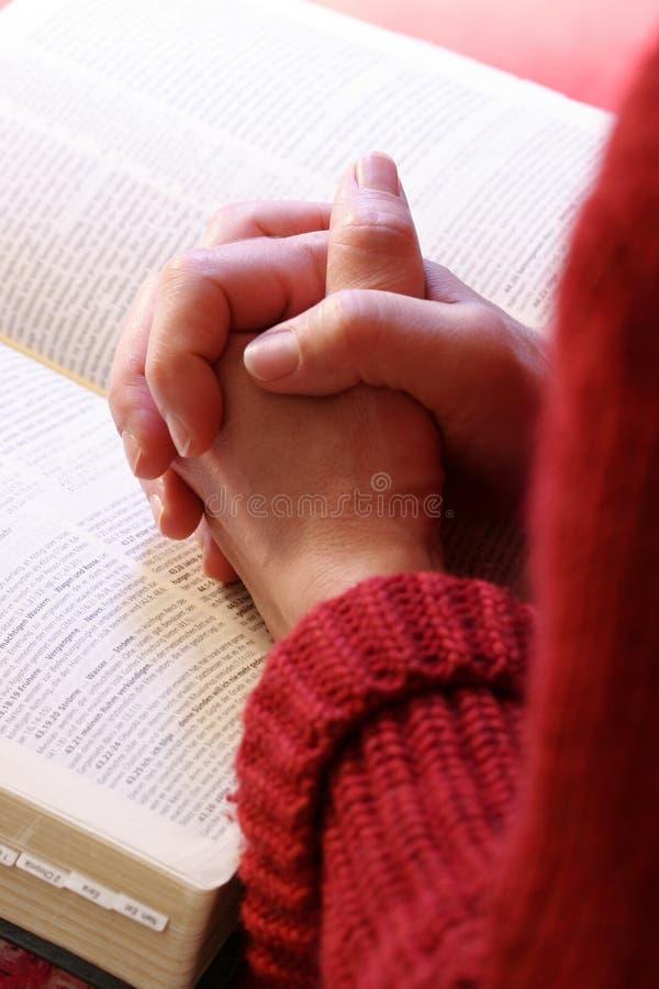 Mani di preghiera immagine stock