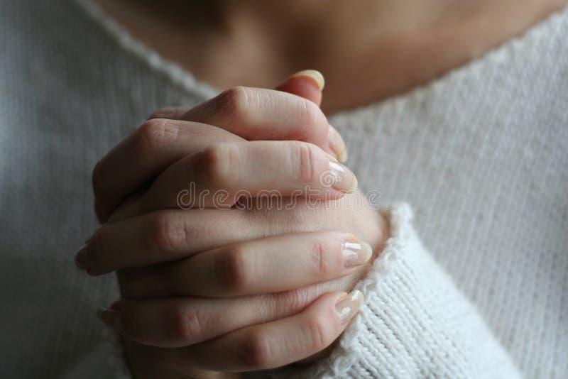 Mani di preghiera fotografie stock