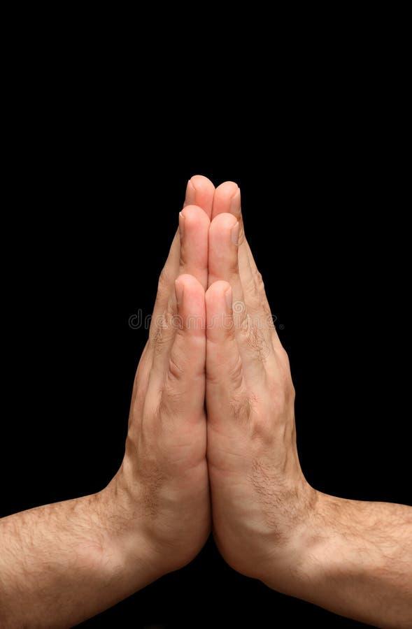 Mani di preghiera di religione immagini stock