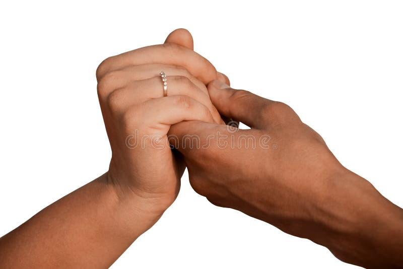 Mani di un uomo e di una donna su un isolatore bianco del fondo immagini stock
