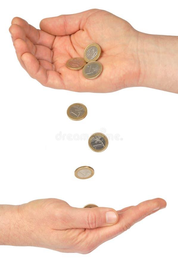 Mani e monete immagine stock libera da diritti