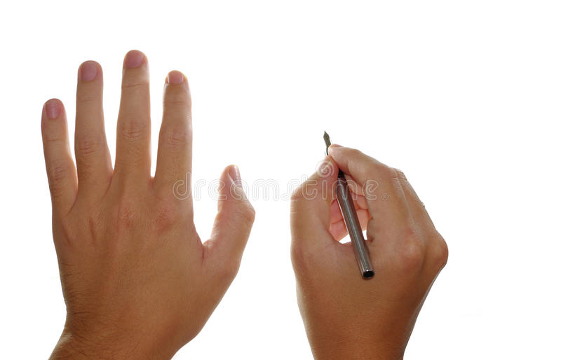 Mani e penna di fontana immagini stock libere da diritti