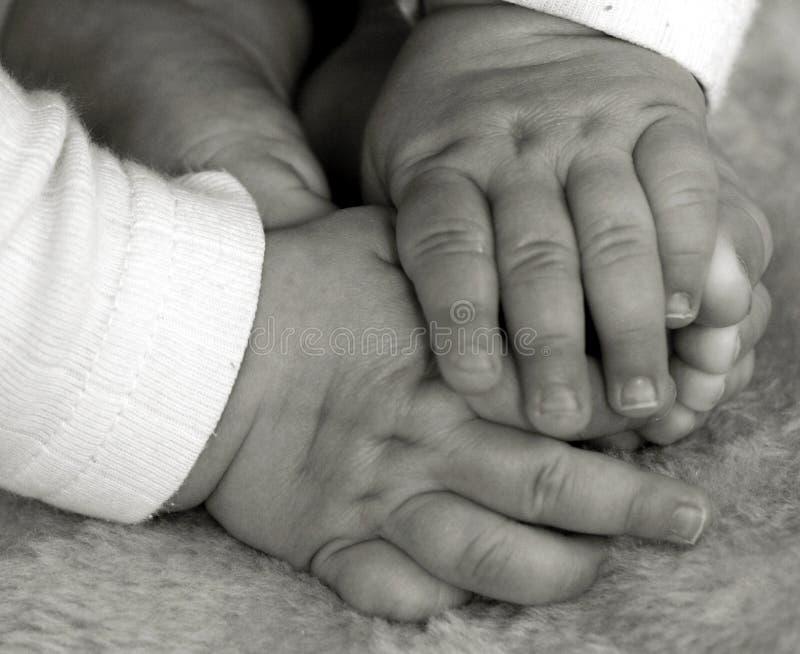 Mani e piedi del bambino fotografie stock libere da diritti