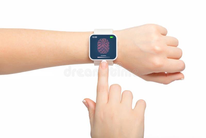Mani femminili isolate con smartwatch con con un'impronta digitale sopra fotografia stock