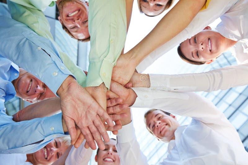 Mani impilate come simbolo per lavoro di squadra immagine stock libera da diritti