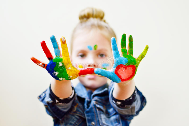 Mani nella pittura fotografia stock
