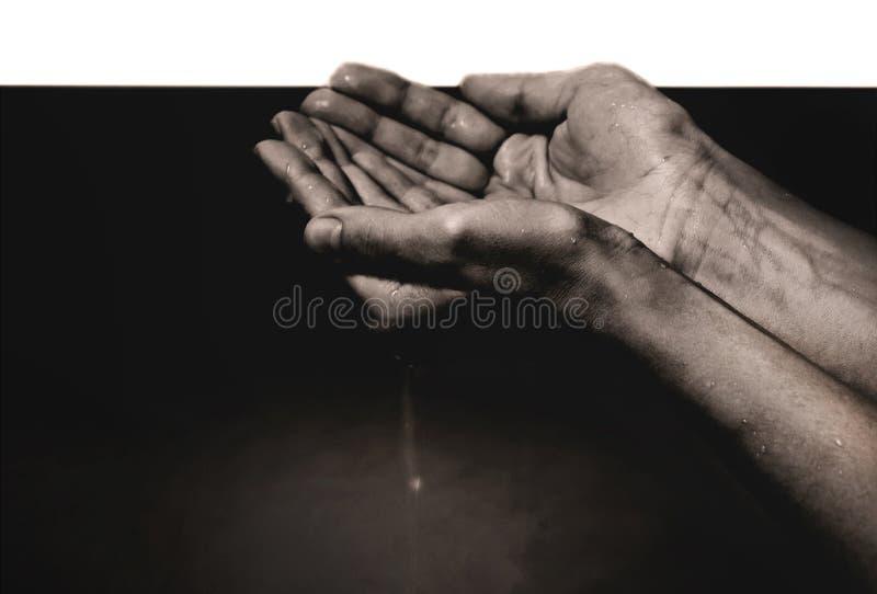 Mani in olio immagine stock libera da diritti