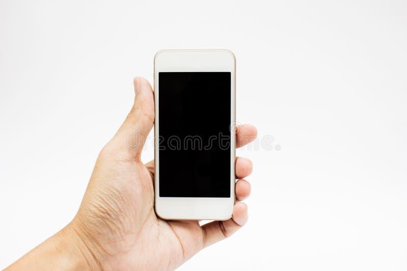 Mani per mezzo del telefono delle cellule fotografia stock libera da diritti