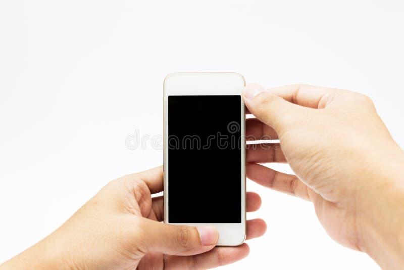 Mani per mezzo del telefono delle cellule fotografia stock