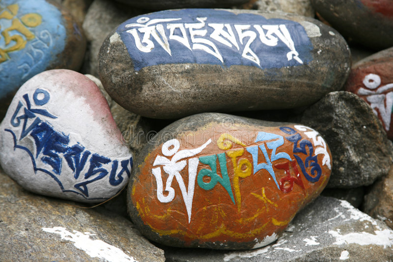 Mani prayer stones. Tibetan mani prayer stones in the Annapurna, Nepal royalty free stock photo