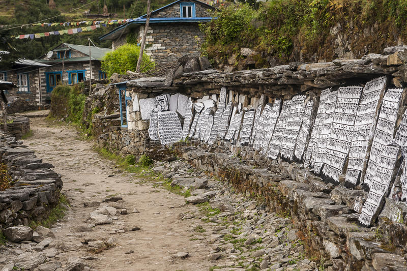 Mani stones. CHAURIKHARKA, NEPAL - CIRCA OCTOBER 2013: Mani stones with the inscription mantra is one of the elements of the Buddhist religion circa October 2013 stock photo