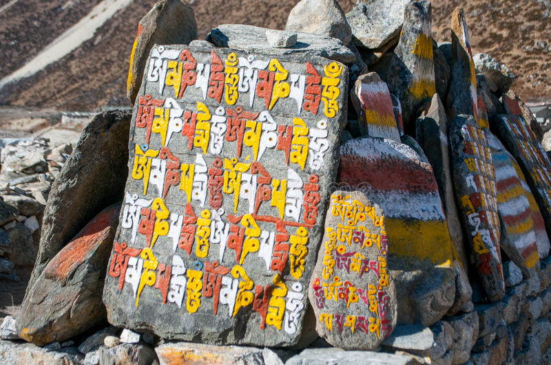 Mani stones. With the inscription mantra is one of the elements of the Buddhist religion stock image