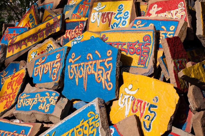 Mani Stones. Are stone plates, rocks and/or pebbles, inscribed with the six syllabled mantra of Avalokiteshvara(Om mani padme hum, hence the name Mani stone) stock image