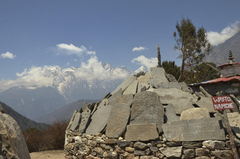 Mani Stones at Tengboche Monastery. Mani Stones and a sign pointing the way to Namche Bazaar on the return trek to Everest Base Camp royalty free stock images