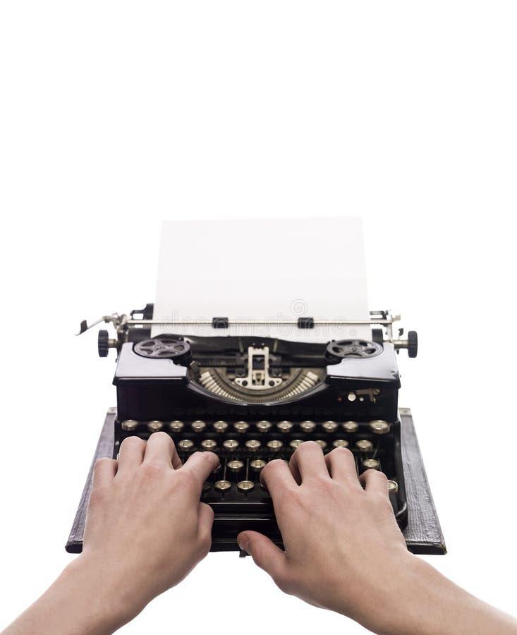 Mani su una macchina da scrivere fotografia stock libera da diritti