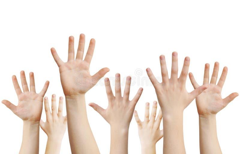 Mani umane sollevate in su immagini stock