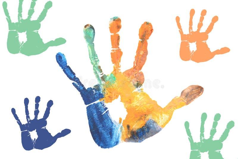 Mani variopinte dei bambini dipinte con i colori di acqua fotografie stock