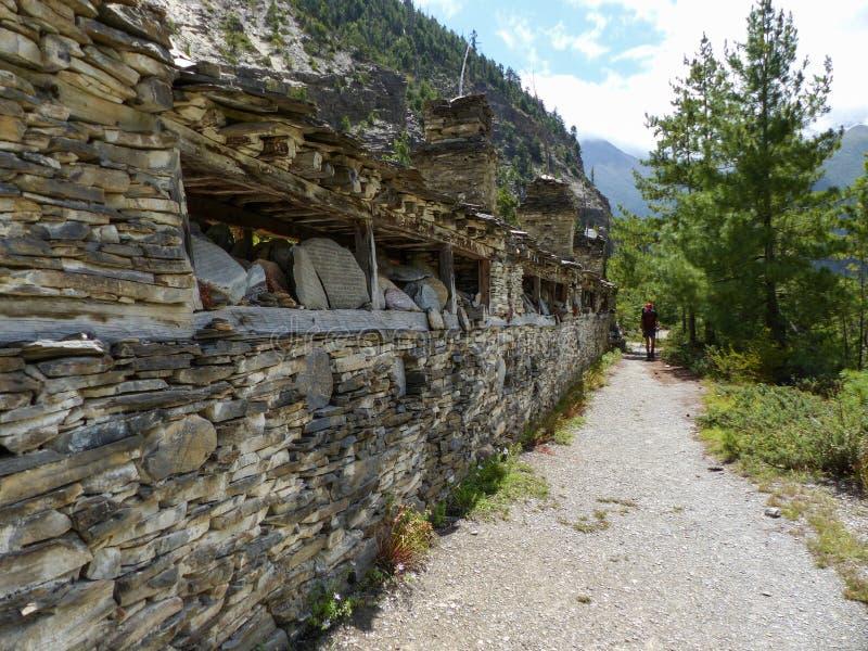 Mani wall near Pisang village. Tibetan Mani wall, Annapurna Circuit trek in Nepal stock image