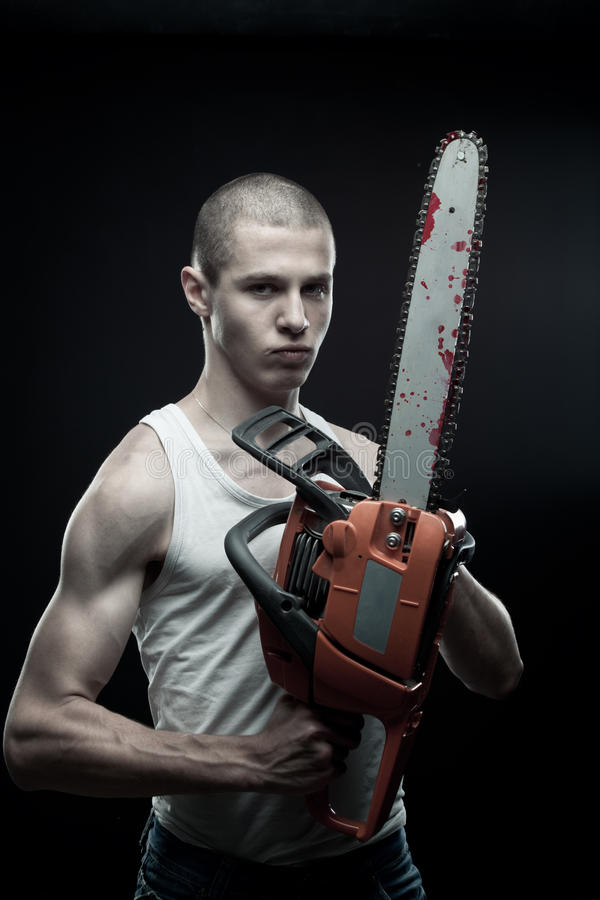 Maniac with chainsaw royalty free stock image