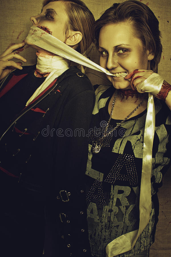 Maniac and her victim stock images