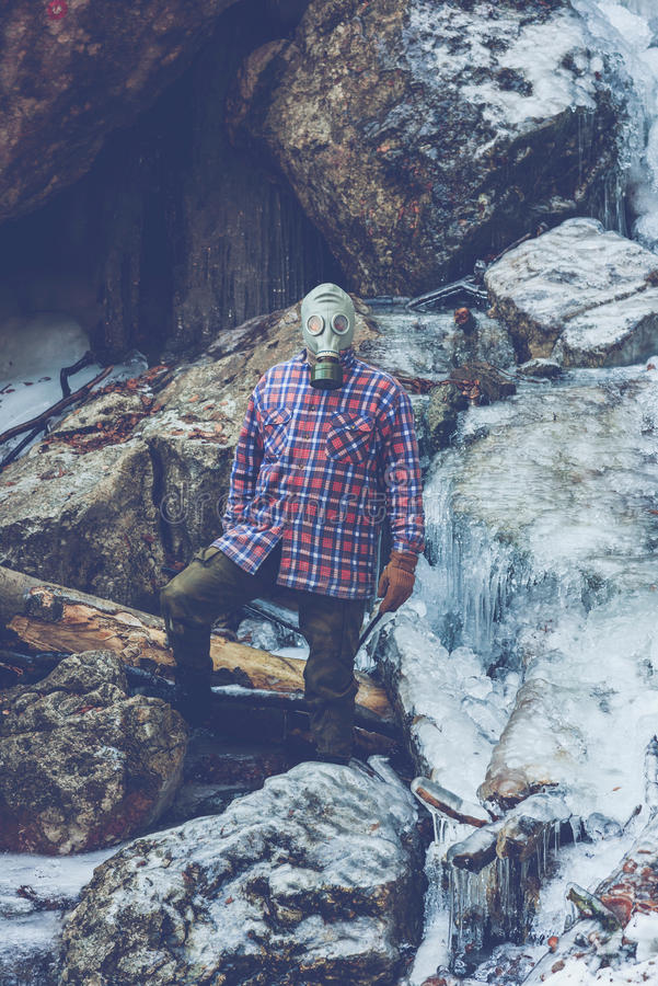 Maniac near to frozen waterfall stock photos