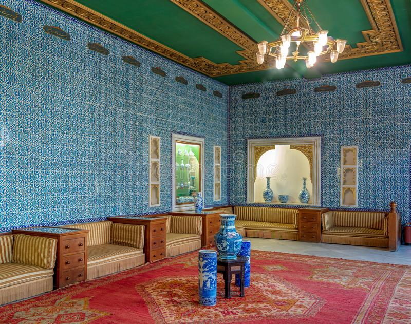 Manial Palace of Prince Mohammed Ali. Blue tiled hall at the residence of the prince`s mother, Cairo, Egypt. Manial Palace of Prince Mohammed Ali. Blue tiled royalty free stock images
