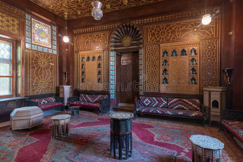 Manial Palace of Prince Mohammed Ali. Guests Hall with wooden ornate ceiling and wooden ornate door, Cairo, Egypt. Manial Palace of Prince Mohammed Ali. Guests royalty free stock images