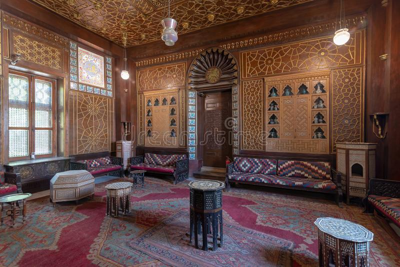 Manial Palace of Prince Mohammed Ali. Guests Hall with wooden ornate ceiling and wooden ornate door, Cairo, Egypt. Manial Palace of Prince Mohammed Ali. Guests stock image