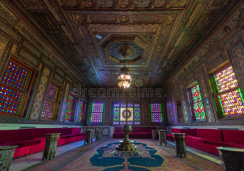 Manial Palace of Prince Mohammed Ali. Syrian Hall with ornate wooden walls and windows with colored stained glass, Cairo, Egypt. Manial Palace of Prince Mohammed stock images