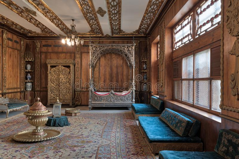 Manial Palace of Prince Mohammed Ali. Residence of prince`s mother with silver bed and golden wardrobe, Cairo, Egypt. Cairo, Egypt - December 2, 2017: Manial stock photos