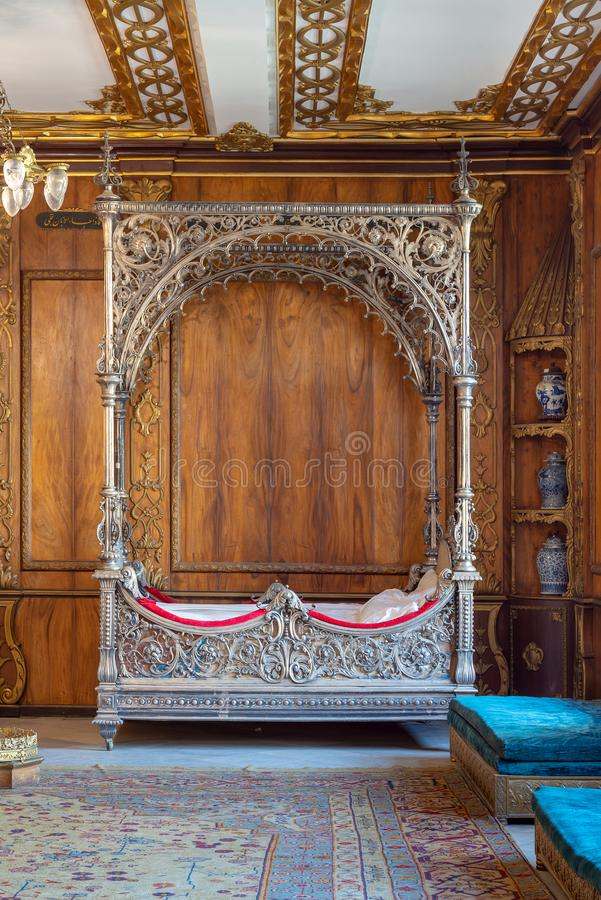 Manial Palace of Prince Mohammed Ali. Silver bed at the residence of prince`s mother, Cairo, Egypt. Manial Palace of Prince Mohammed Ali Tawfik. Silver bed at stock photos