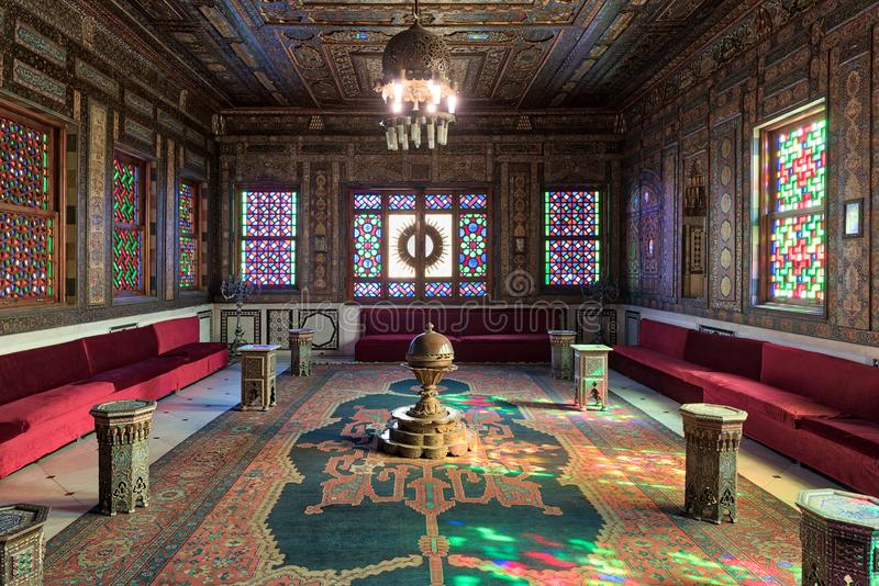 Manial Palace of Prince Mohammed Ali. Syrian Hall with ornate wooden wall and ceiling, Cairo, Egypt. Cairo, Egypt - December 2 2017: Manial Palace of Prince stock photo