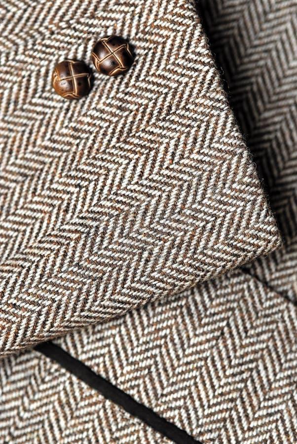 Manicotto del rivestimento di colore marrone del tweed fotografia stock libera da diritti