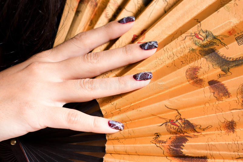 Manicure. Exotic Manicure for young woman cosmetic with fan More cosmetics pictures here royalty free stock image
